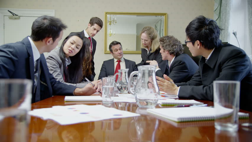 4k / Ultra HD version Diverse group of business people are seated around a conference table for a meeting. They are examining graphs and diagrams and discussing their business strategy.  | Shutterstock HD Video #14048825