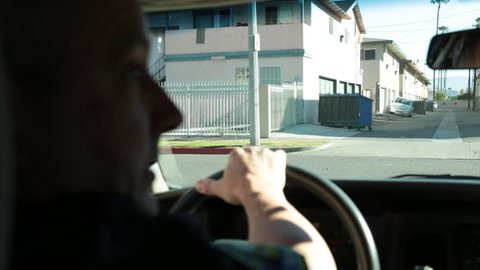Anaheim, CA., January 2016: Policeman driving his patrol car through back streets of Anaheim, CA