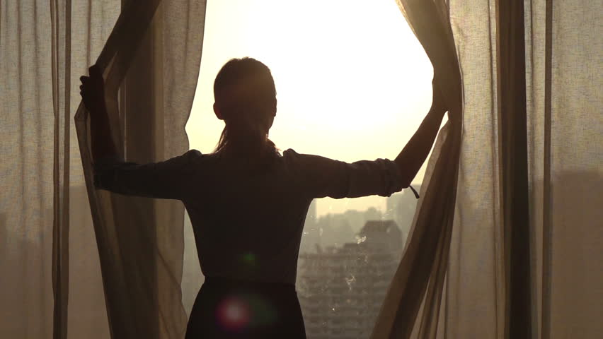 Woman  unveil curtains in room in the morning, 240fps