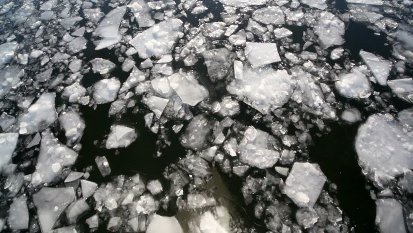 Downward movement of ice cracked, view from boat reflecting in water