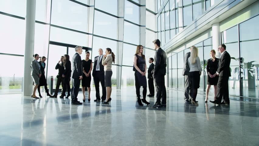 4k / Ultra HD version Diverse group of business people, stand and chat to each other in a light and modern glass fronted office building on a bright day. In slow motion. Shot on RED Epic   Shutterstock HD Video #14127389