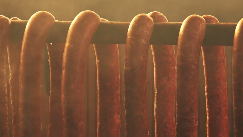 Smoking homemade pork sausages, food preparation process of cured pork meat delicacy in smokehouse. | Shutterstock HD Video #14167529
