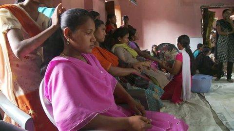 Baruipur, India - CIRCA 2013 - Indian women getting their hair styled