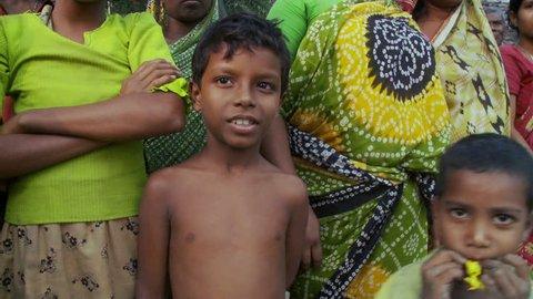 Baruipur, India - CIRCA 2013 - Kids in jungle laugh act camera in India