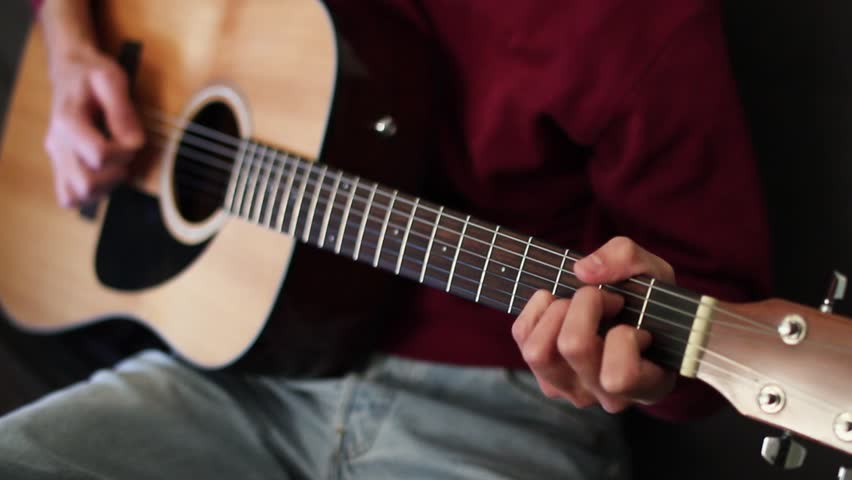 Musician playing on acoustic guitar. Acoustic concert.