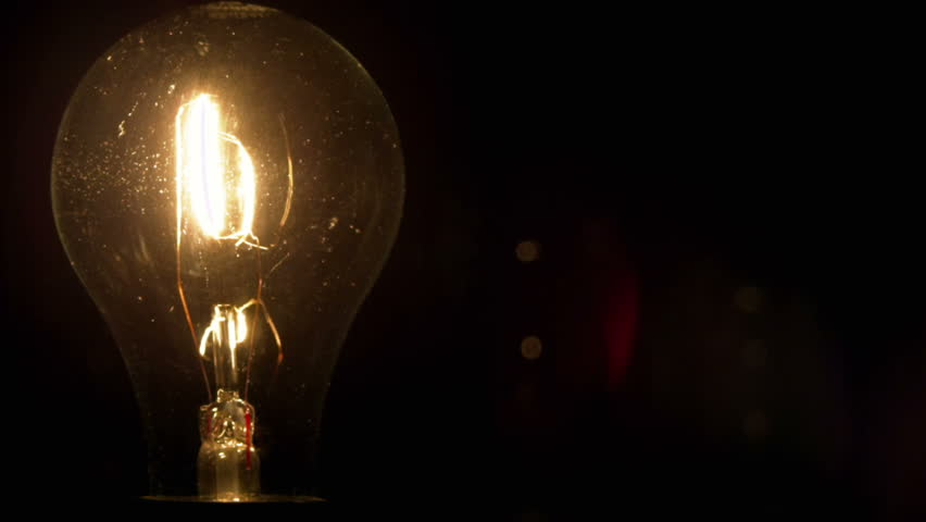 A light bulb illuminates a dark room, much like an idea in our mind.