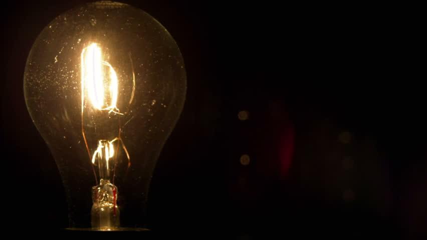 lighting a dark room. a light bulb illuminates dark room much like an idea in our mind lighting h