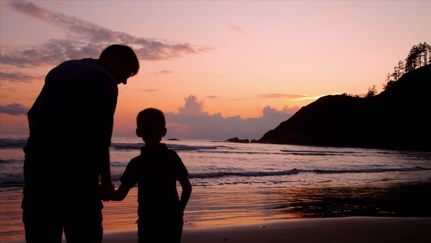 Grandparents and grandchildren enjoy a day at the beach.  Their activities include using a computer, walking on the beach, watching the sunset, having a drink, holding hands, and sharing an embrace.