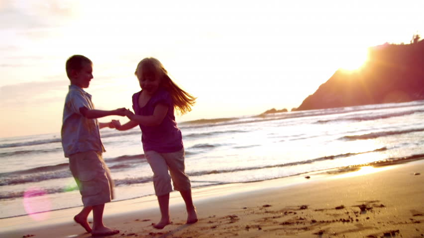 Grandparents and grandchildren enjoy a day at the beach.  Their activities