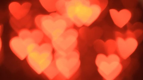 Valentine's day abstract background,flying hearts  bokeh and particles.Loopable.
