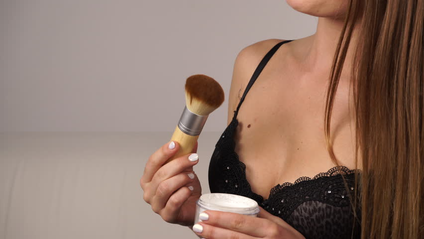 Image result for woman applying body powder