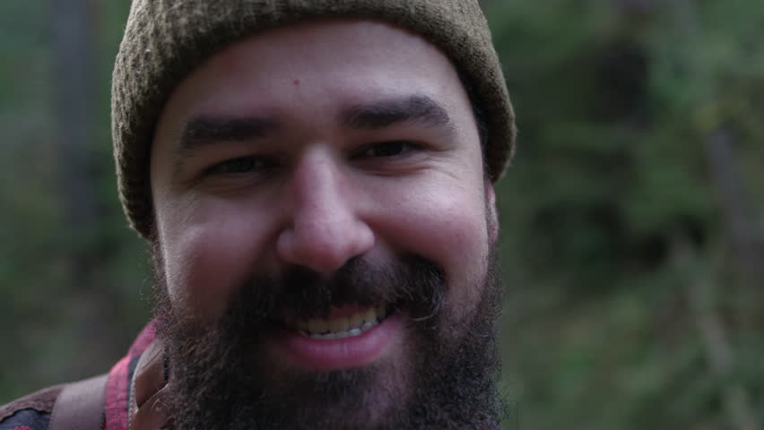 Portrait of a smiling lumberjack woodsman in flannel out in the forest. | Shutterstock HD Video #14310379