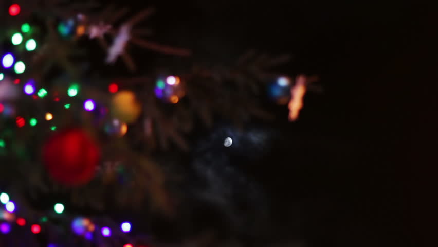 Christmas Tree Decorated With Toys And Lights At Night On A Background Of The Moon