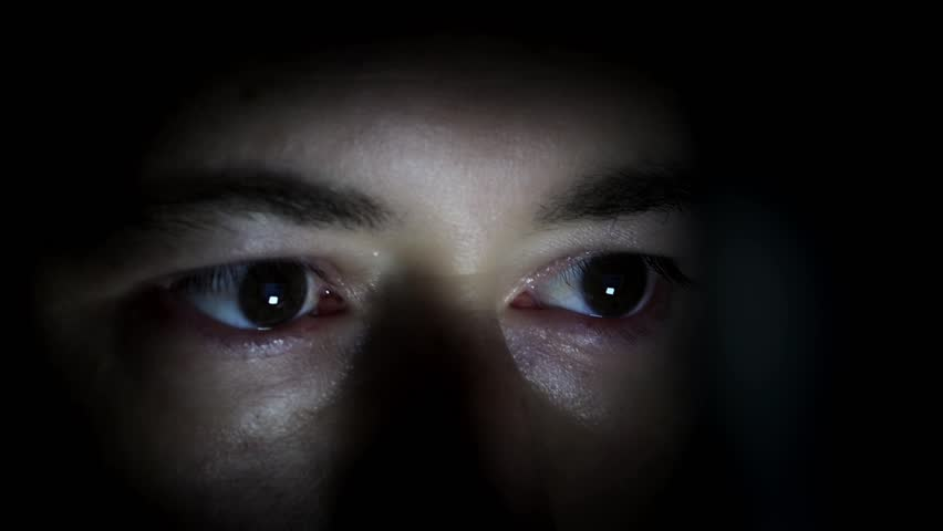 Man hidden in the dark with light in the eyes. Scared Man's Eyes hidden in the dark - 1080p