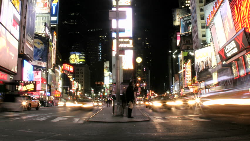 NEW YORK, NY - CIRCA 2005: A slow left pan of an accelerated shot of traffic and pedestrians in Times Square circa 2005 in New York, NY. | Shutterstock HD Video #1446763