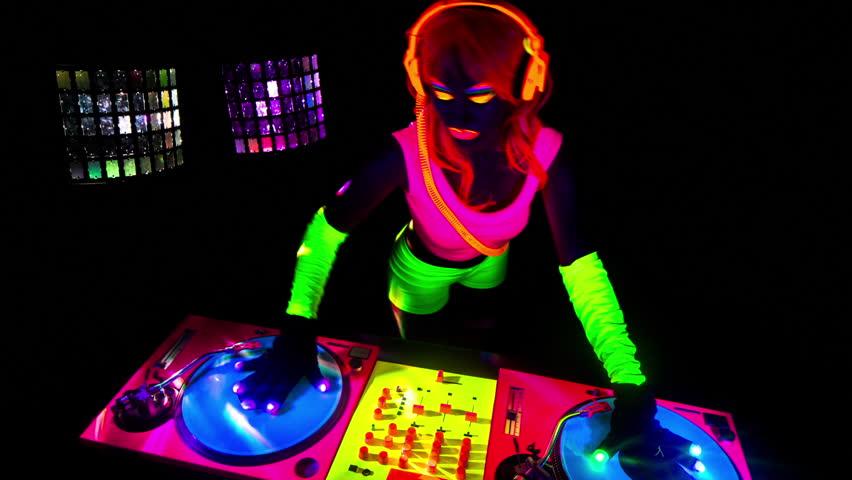 Sexy female DJ mixes in a club in UV fluorescent costume | Shutterstock HD Video #14477389