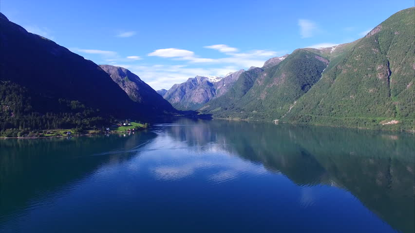 Tranquil scenery of calm fjord with mountains reflecting on the tranquil scenery of calm fjord with mountains reflecting on the water surface sognefjorden in norway voltagebd Images
