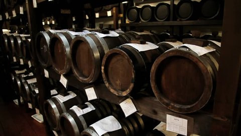 MODENA, ITALY – MAY 15, 2013: View to the balsamic vinegar barrels for storing and aging in a cellar in Modena, Italy.