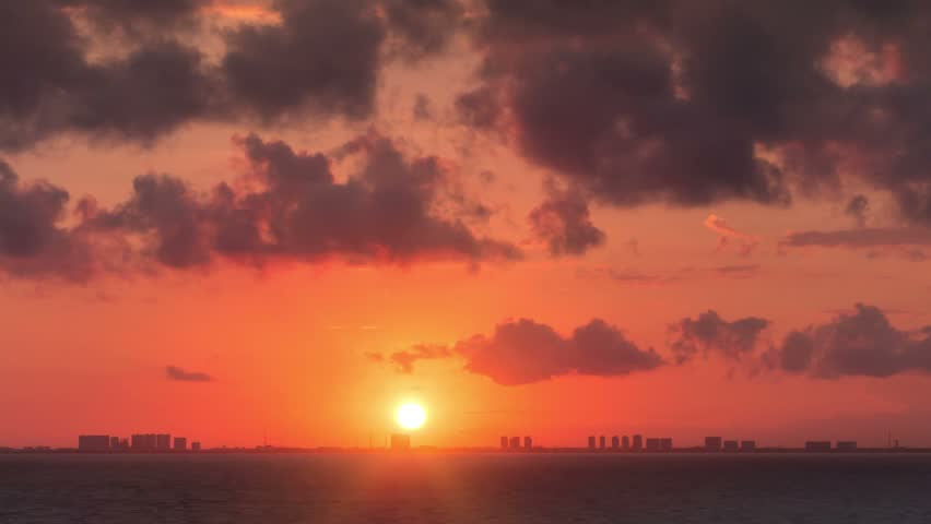 Time lapse of cancun skyline cityscape day to night transition zoom out