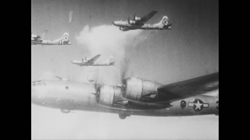 UNITED STATES 1940s: Aerial view of bombers / Plane drops bombs / Planes drop bombs / Bombs dropping / Plane drops bombs / Bombs dropping / Aerial views, explosions over Japan / View of parade.