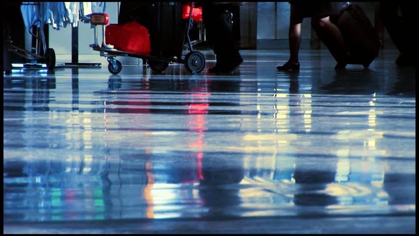 People travelling through airport terminal