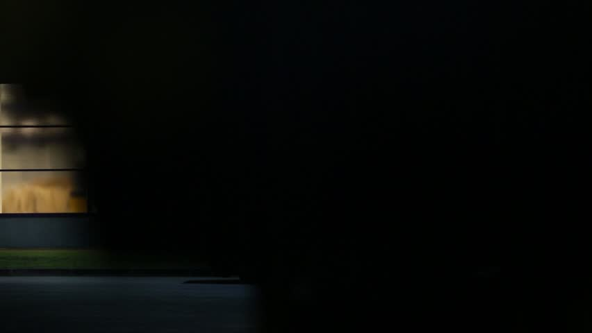 Aerosol Can Of Spray On Black Background Slow Motion