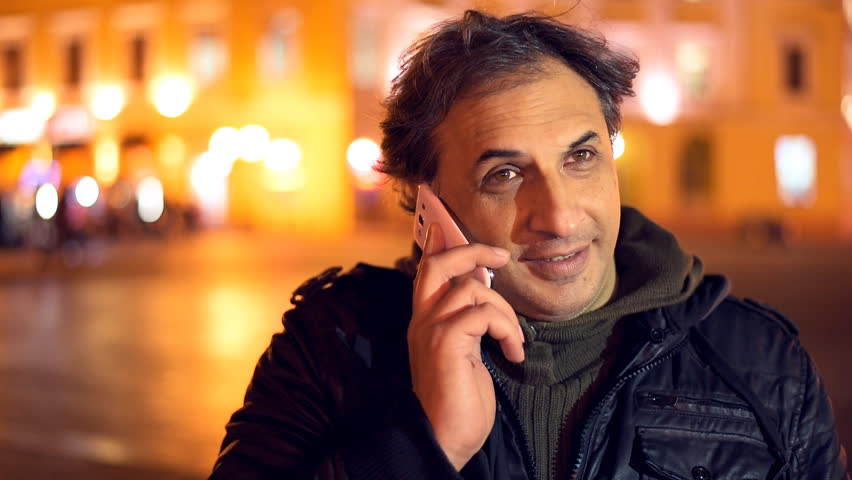 Man talking on cellphone in the outdoors. | Shutterstock HD Video #14624839