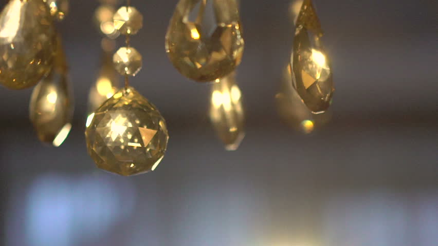 Luxury crystals of a classic chandelier on a dark background. Slow motion - HD stock footage clip