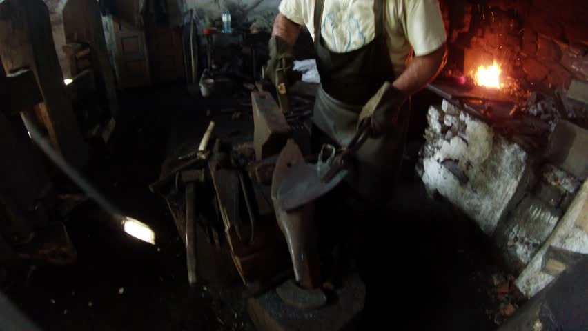 Gamora - forge working on a water drive - almost unique still working in the world forge, the historical value built in the 19th century by the Czech project in the foothills of the Carpathians | Shutterstock HD Video #14663029
