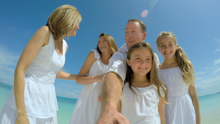 Video selfie of smiling carefree Caucasian family on beach   Shutterstock HD Video #14689579