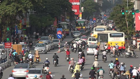 HANOI, VIETNAM - 2 DECEMBER 2015: Rush hour in Hanoi, motorbikes and other traffic navigate through busy streets, Vietnam infrastructure and travel