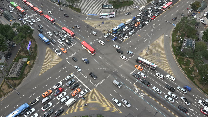 SEOUL, SOUTH KOREA - 7 OCTOBER 2015: Busy rush hour traffic driving over an intersection in the Gangnam district in Seoul, South Korea #14755579