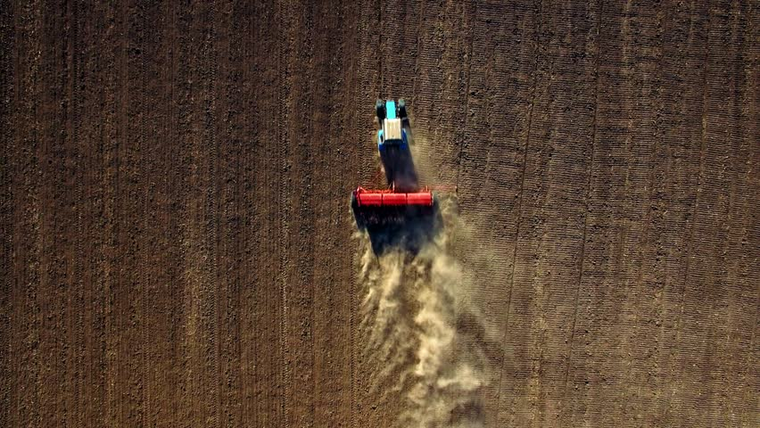 Aerial top view of tractor sowing wheat