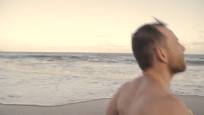 Beach Runner at Sunset / Man running on the beach at sunset | Shutterstock HD Video #14809939