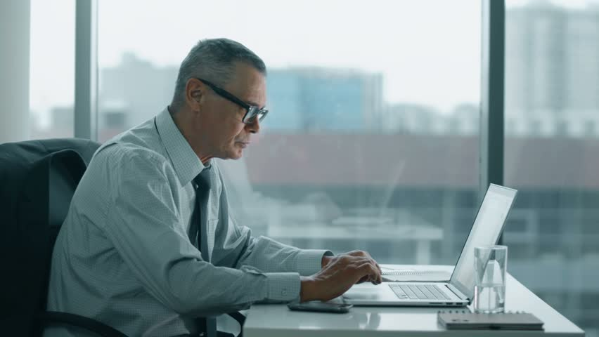 Elderly businessman working with computer in modern office | Shutterstock HD Video #14813083