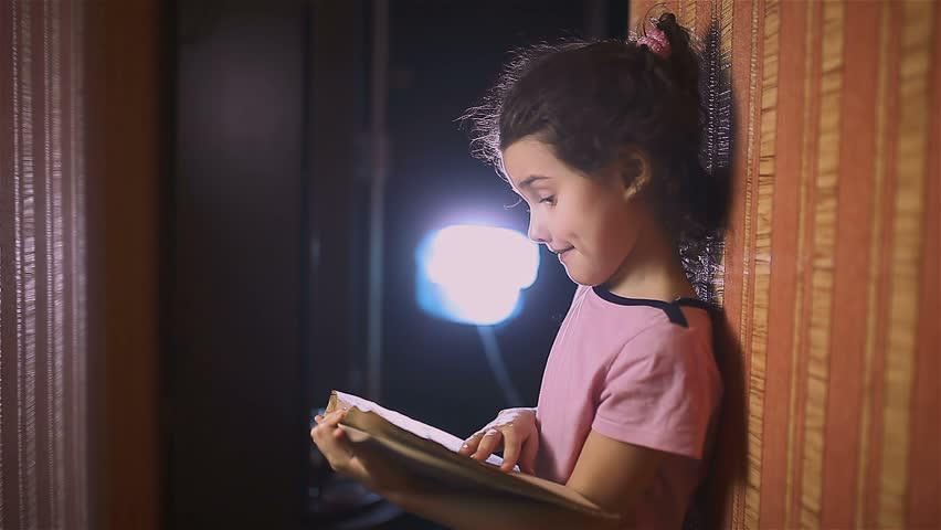 Teen girl  reading book is wall education indoor  | Shutterstock HD Video #14849299