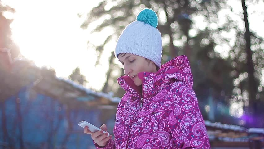 Girl send sms in winter forest | Shutterstock HD Video #14863819