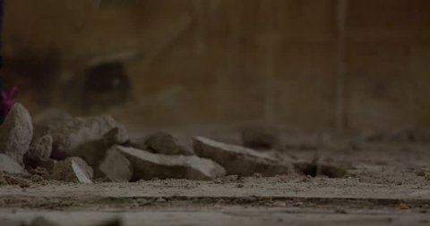 Close-up redecorationg a house: worker with a sledgehammer. 4K video footage