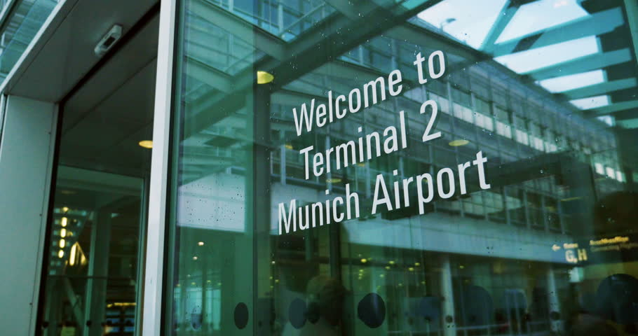 MUNICH, GERMANY - CIRCA 2016: Welcome to Munich airport with passengers entering the door to Terminal