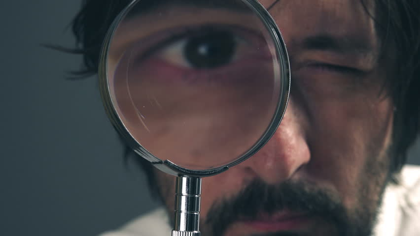 Businessman with magnifying glass, tax inspector doing financial auditing or consultancy.