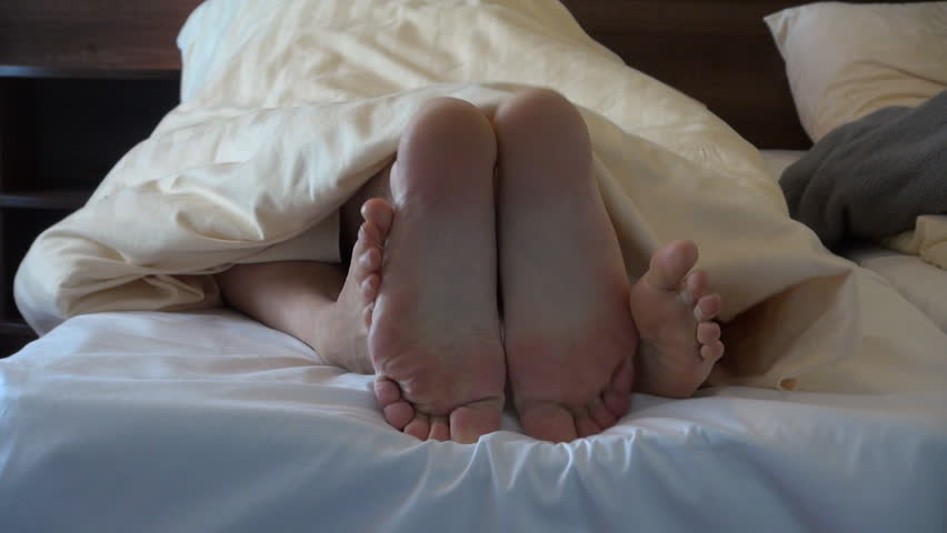 Man and woman feet romance in bed | Shutterstock HD Video #14912875