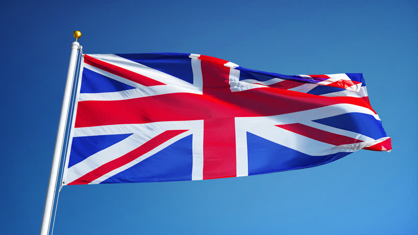 Great britain flag waving in slow motion against blue sky, seamlessly looped, close up, isolated on alpha channel with black and white luminance matte, perfect for film, news, digital composition