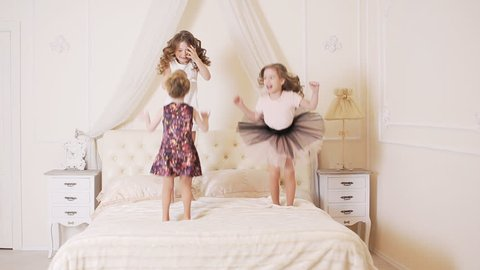 little kids jumping on the bed