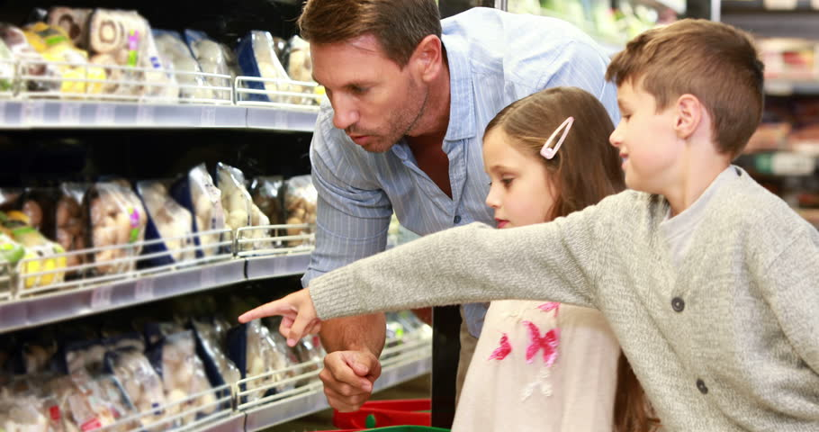 Father and daughter picking out salad in supermarket in high quality 4k format | Shutterstock HD Video #14949199