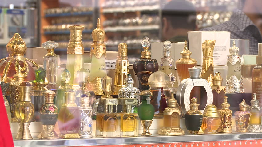Perfume Shop, Al Fahidi Street. Medium close up of a shop window arrayed with exotic richly decorated bottles full of locally made perfume.