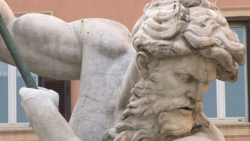 the threatening face of the Neptune statue in the fountain in Piazza Navona/ the face of the statue of Neptune /ROME, ITALY, JUNE 21 2015