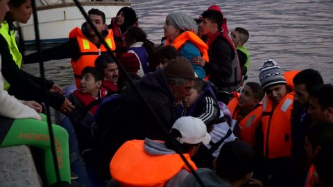 Refugees who were rescued in the sea. The boat has come on the coast of Lesvos, Greece. Everning. November, 2015