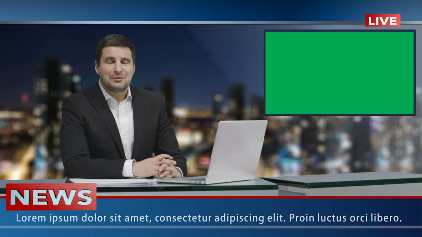 Media broadcaster is sitting at a table and talking. Display with Green Screen. News show Mock-up.