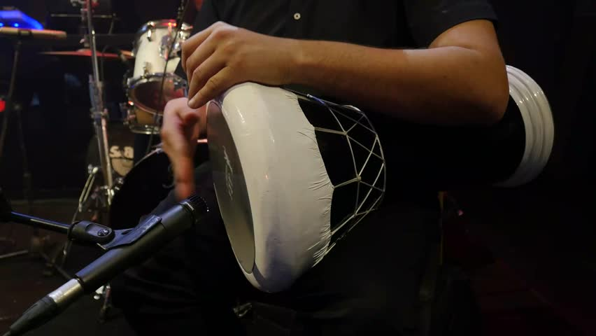 Performance of a man on a Goblet Drum ( Darbuka )