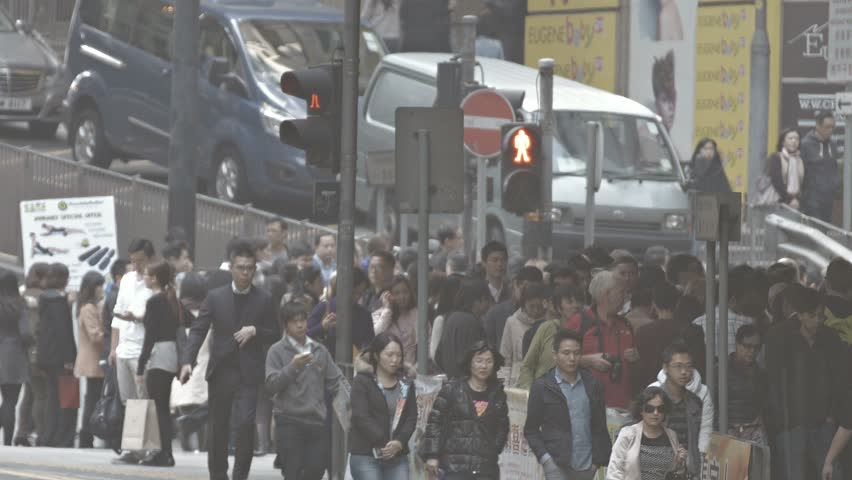 HONG KONG. CHINA - CIRCA JAN 2015: Heavy pedestrian traffic on a busy sidewalk in Hong Kong. China. FullHD video #15047119